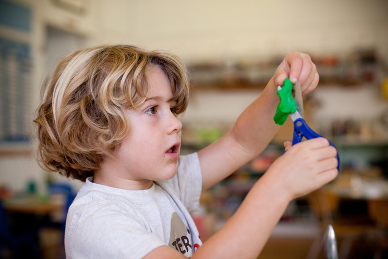Child using play dough